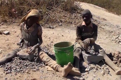 George, a stone-breaking child with a broken future in Haut-Katanga