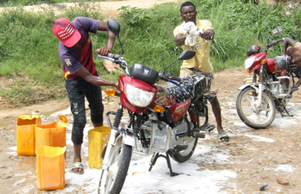 In Bunia, Olivier and Héritier prepare their return to school in a motorcycles washing station