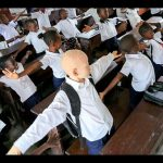 Tresor, albino, goes to school like everyone else
