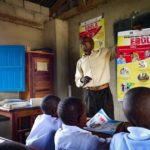 A teacher involved in handwashing in Beni